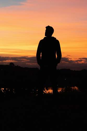 nature silhouette of man under yellow sky outdoors
