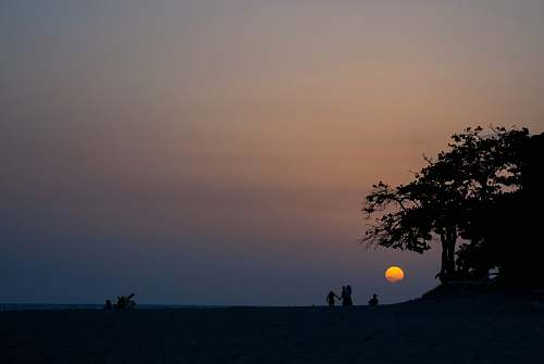 sky silhouette of people and tree during sunset cuba