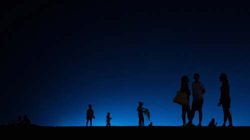 human silhouette of people during nighttime person