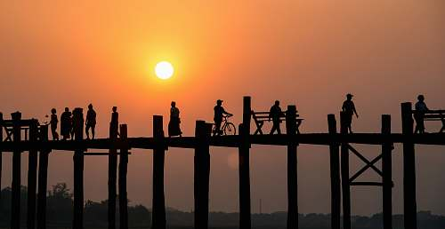 human silhouette of people on bridge person