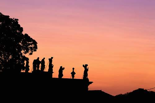nature silhouette of people on top of mountain sunset