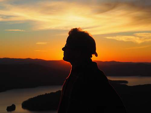 nature silhouette of person facing right side during golden hour sunset