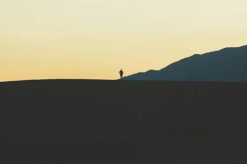 nature silhouette of person standing on mountain person