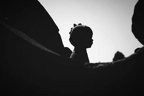 black-and-white silhouette of statue during daytime human