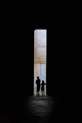 people silhouette of two persons standing between doors iphone wallpapers