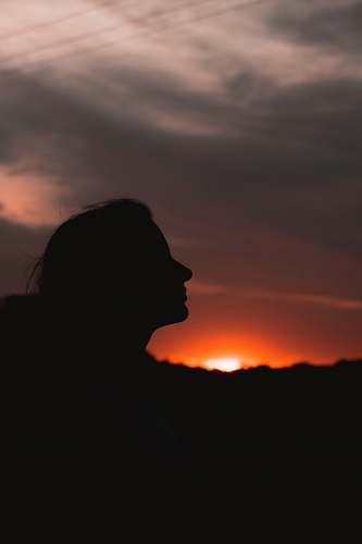 nature silhouette of woman during golden hour outdoors