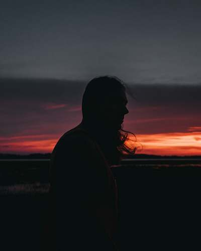 nature silhouette of woman near mountain outdoors