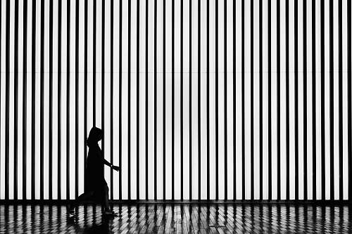 black-and-white silhouette on walking woman tokyo