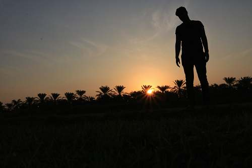 human silhouette photo of man standing on ground person