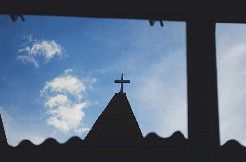 architecture silhouette photography of a cross during daytime building