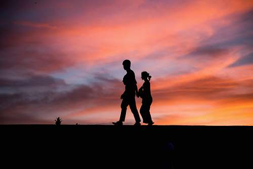 human silhouette photography of man and woman people