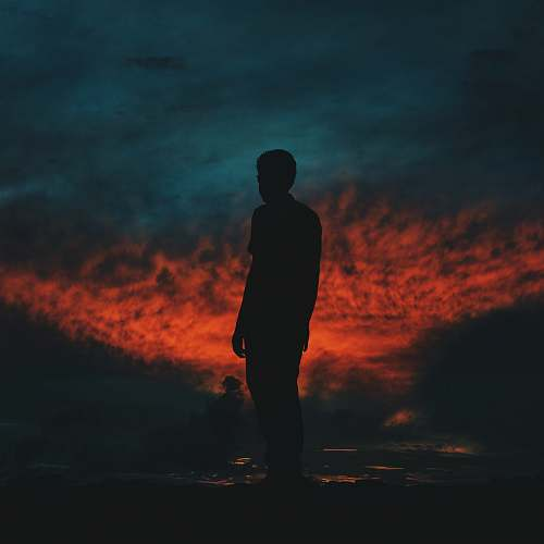 person silhouette photography of man standing on ground people