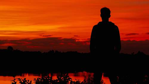 nature silhouette photography of person sunset