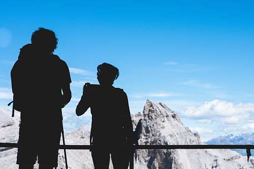 photo human silhouette photography of two person standing on top under clear blue sky people free for commercial use images