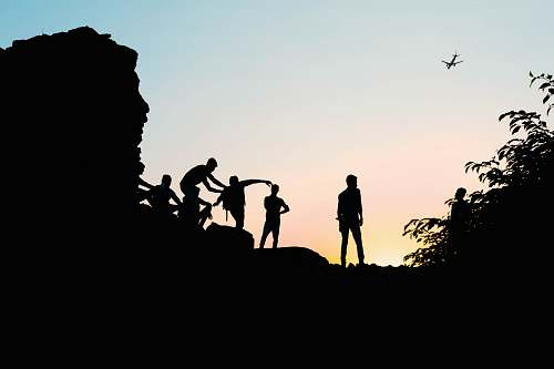 person silhouette view of men on the hill human