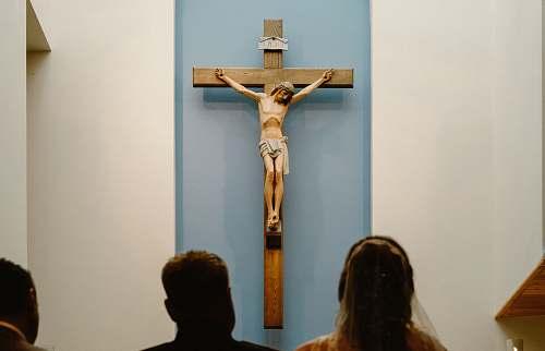 emblem three people staring at the crucifix crucifix