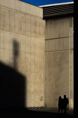 human two silhouette of person standing near wall person