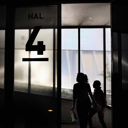 human two woman walking through door people