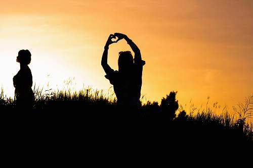 human woman doing heart hand sign person