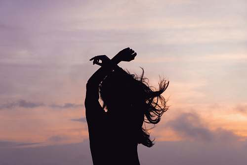 nature woman waving her hair outdoors