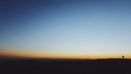 sunrise blue and brown ombre sky on horizon panoramic photo landscape