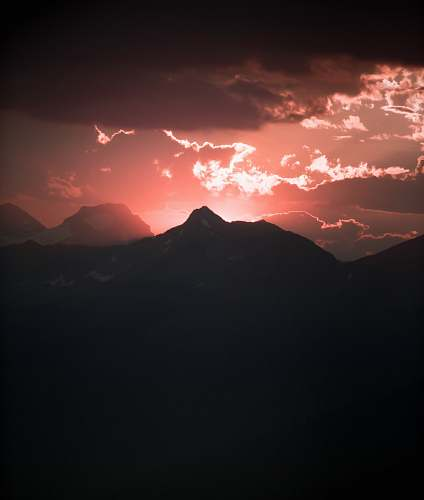cloud silhouette of mountain under red sky panoramic photography mountain