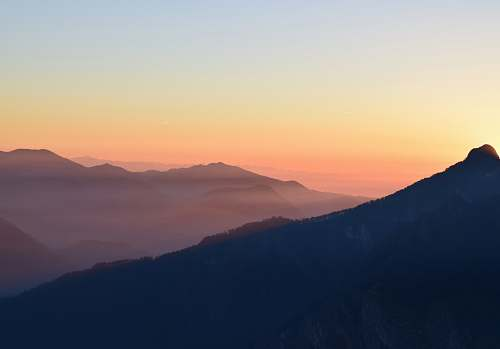 sunrise aerial photography of mountain sky
