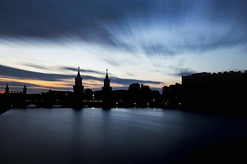 dusk body of water near concrete buildings architecture