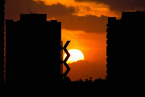 nature silhouette photography of buildings outdoors
