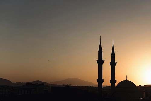 building two mosque minarets under calm sky architecture