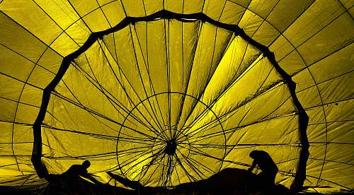 parachute silhouette of two persons working silhouette