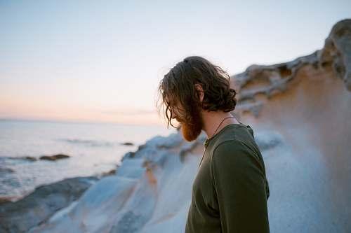 man man in green shirt on seaside male