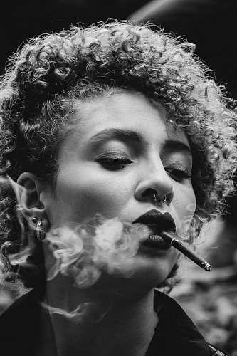 people grayscale photo of woman smoking human