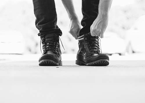 boot person wearing black leather lace-up boots clothing