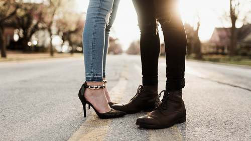 shoe worm's eye view photography of man and woman facing each other boot