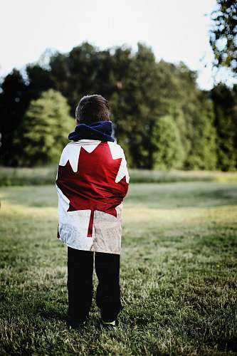 person child wearing Canada flag people