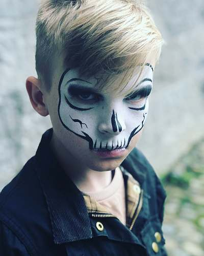 person child with skull face painting people