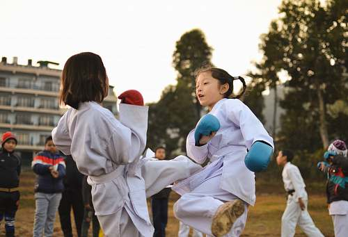 people children participating in martial art sparring person
