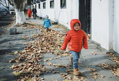 people children walking beside street person