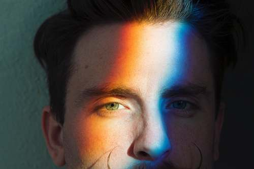 person closeup photo of man's face with light reflections people