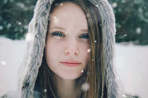 people focus photo of a woman's face wearing parka hoodie person