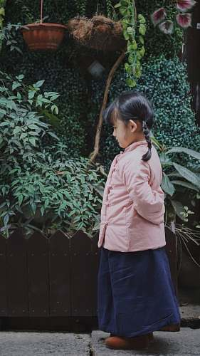 people girl standing in front of garden person