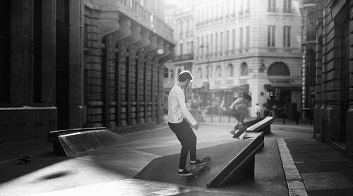 people grayscale photography of man skateboarding black-and-white