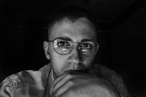 people greyscale photo of man wearing eyeglasses black-and-white