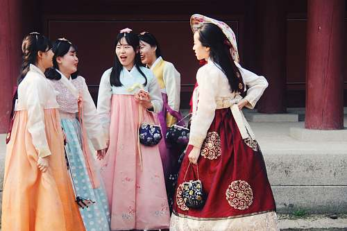person group of woman wearing traditional dresses people