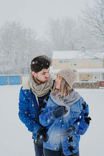 people man and woman standing outside during winter person
