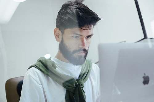 person man facing MacBook Pro people