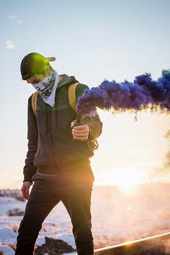 people man holding purple flare person