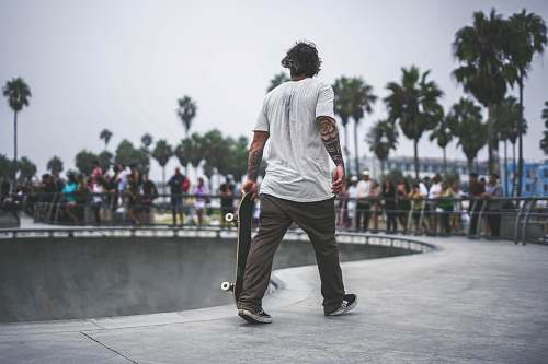 people man holding skateboard in skate park person