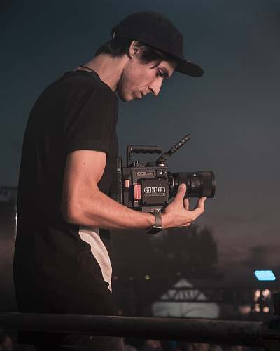 person man holding video camera people